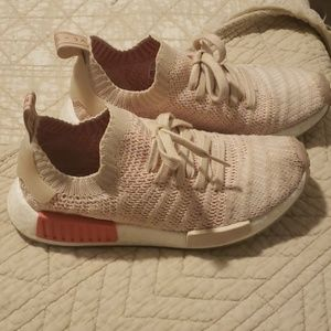 Adidas NMD coral and light beige shoes.